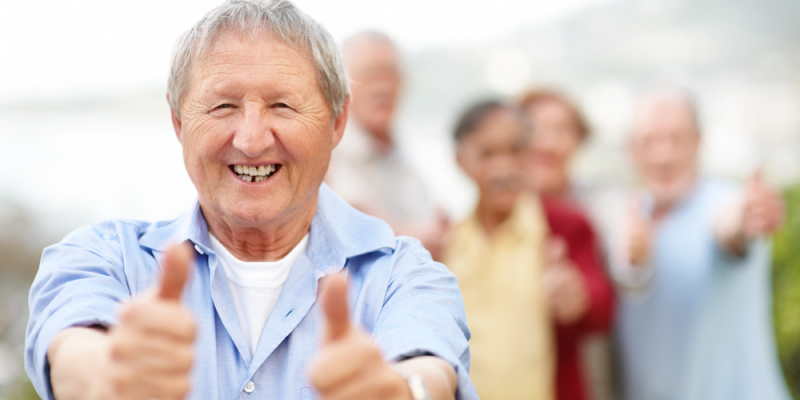 Man giving thumbs up sign