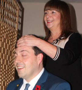 The Minister for Sport, Health Improvements and Mental Health gamely tries out an Indian head massage at Cope Scotland